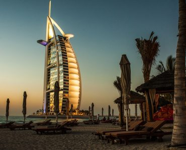 The sun beautifully painted burj-al-arab, Dubai,  in orange during sunset