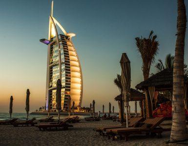 The sun beautifully painted burj-al-arab, Dubai, in orange during sunset
